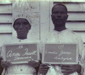 Image of Ann Tuitt and Cornelius Jarvis. Part of a larger photograph of people serving prison sentences for obeah in the Antigua prison, 1905. TNA CO 152/287. Courtesy of The National Archives, UK